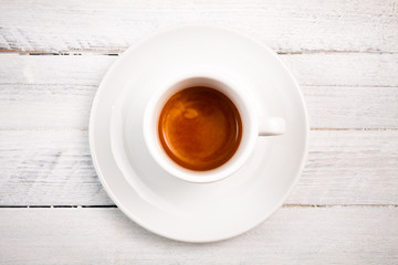 top view a cup of espresso coffee, white wooden background