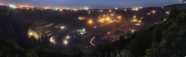 Wide angle night shot of the biggest open pit in Krivoy Rog