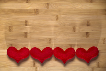 four red heart on wood
