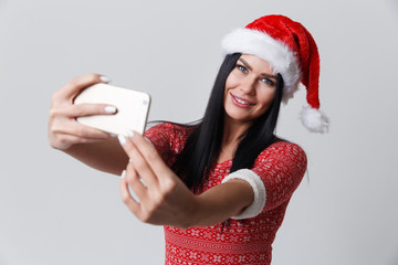 Brunette in Christmas with smartphone