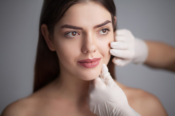 Skin care woman removing face makeup - skin care concept / photos of appealing brunette girl