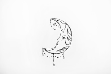 Sketch of the moon with patterns on a white background.