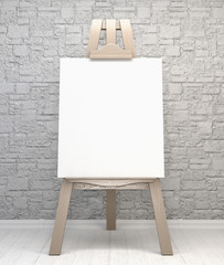 Vintage retro wooden easel artist's with blank canvas on a brick