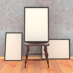 Simple wooden chair with three blank canvas in a black frame on