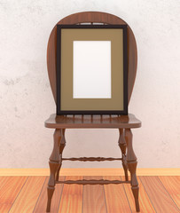 Simple wooden chair with blank canvas in a black frame on the
