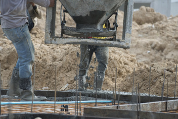Workers were pouring concrete in construction site.