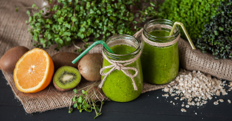 Green smoothies with micro greens, kiwi and orange juice