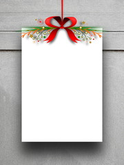 Blank frame hanged by red Christmas ribbon against gray concrete wall background