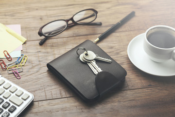 wallet with key on wooden table