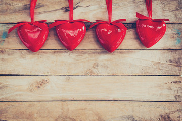 Decorative red hearts hanging on vintage wooden with space. Vale