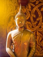 close up Golden Monk statue. golden buddha, buddhism concept.