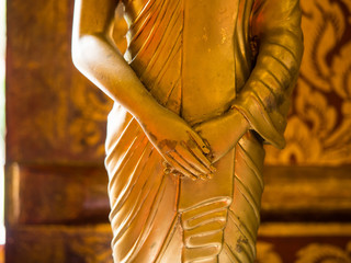 Close up hand of statue Buddha, buddhism concept