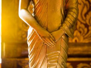 Close up hand of statue Buddha, buddhism concept