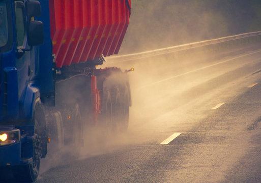 heavy-duty truck on a wet road