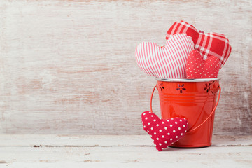 Valentine's day concept with heart shapes in bucket