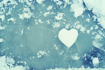 Heart from snow on ice. Snow Heart. Love concept. Valentine background.