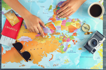 Adventure concept. Woman planning her vacation using map