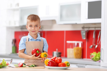 Little boy cooking in the kitchen