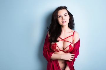 Passionate woman with big beautiful breasts in sexy red lingerie.