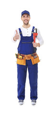 Smiling plumber holding screw-wrench on white background
