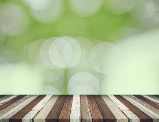 Wood table top on green bokeh abstract background