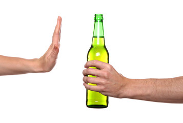 Female hand refusing bottle with beer on white background