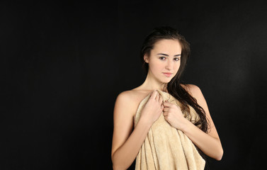 Young beautiful woman in towel after shower