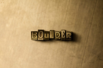 BOULDER - close-up of grungy vintage typeset word on metal backdrop. Royalty free stock - 3D rendered stock image.  Can be used for online banner ads and direct mail.