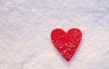 Red felt heart on snow, Valentine's Day. Copy space for text. Snowflakes on heart. Valentines day, love concept. White background