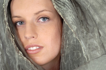 Woman with silk veil closeup