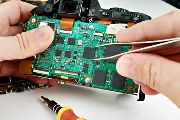 Repair broken photo digital SLR camera in service