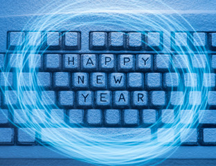 keyboard with inscription Happy New Year illuminated by blue light