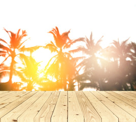 Blurred background, sunrise at coconut tree with wood floor