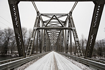 Steel bridge covered in snow