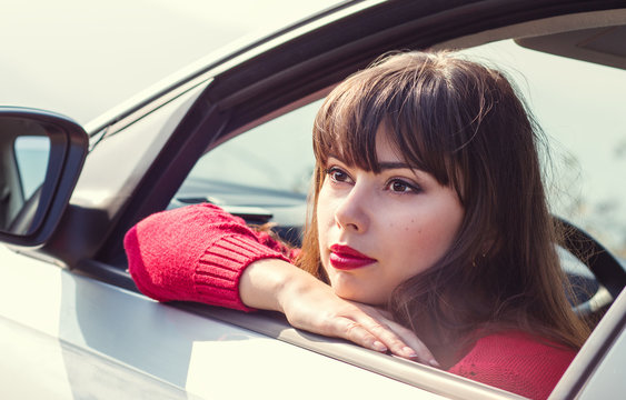 attractive young woman driving a car