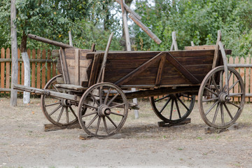 Vintage rustic wooden horse-drawn carriage in Polish farm
