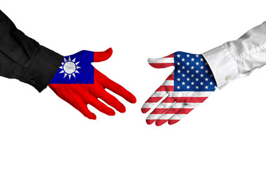 Taiwan and United States leaders shaking hands on a deal agreement