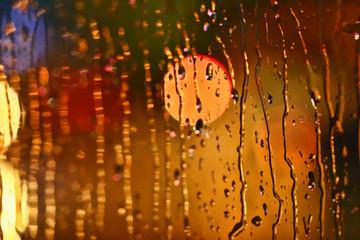 Photos night city made through glass. Street. Rain.