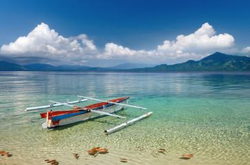 Traditional Indonesian boat on the background of islands