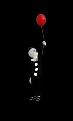 Clown mit rotem Ballon