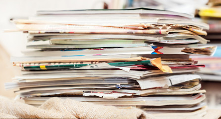 Disorderly pile of magazines and newspaper