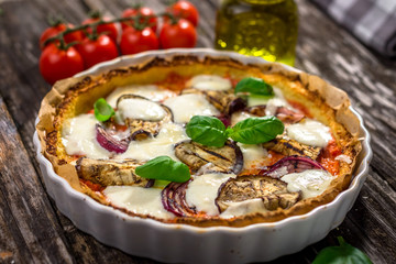 Vegetable pizza  with mozzarela  cheese, basil and olive oil