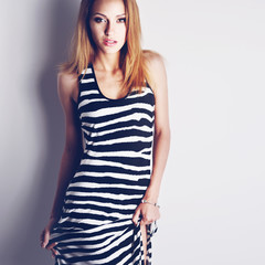 pretty woman wearing zebra dress