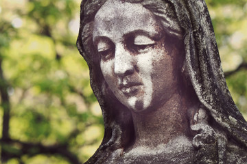 Statue of Virgin Mary in tears (sadness, regret, fear, religion)