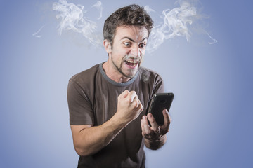 Angry man shouting at his cell phone, smoking with rage, smoke coming out his ears