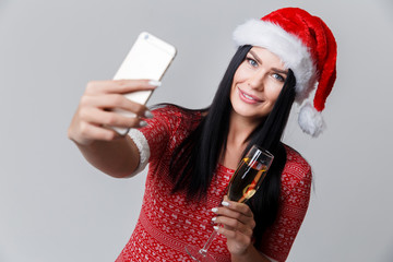 Woman in Christmas photographing herselves