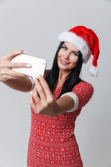 Girl in Christmas with smartphone
