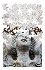 Sculpture of an angel on a wooden door - concept image in puzzle shape