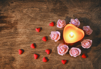 valentine's day, dark background candle heart, confetti, pink rose