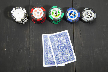 Playing poker on black wooden table